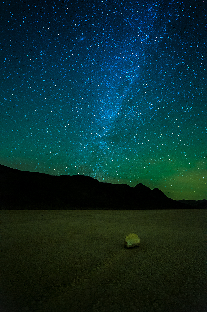 Night photo Racetrack Playa dry lake bed with prominent view of milky way. Death Valley